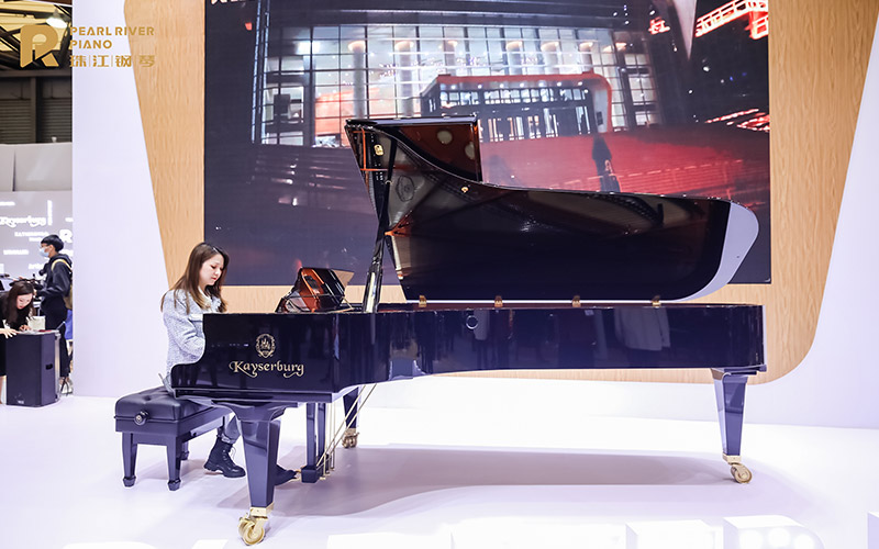 Enjoying playing one of our concert grand pianos